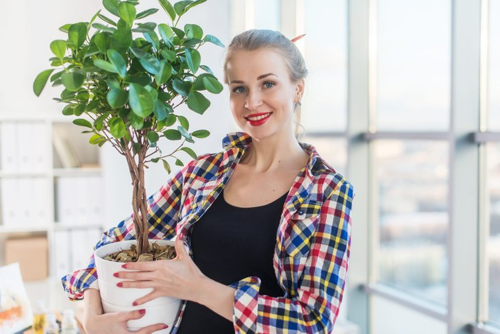 Woman with plant at home
