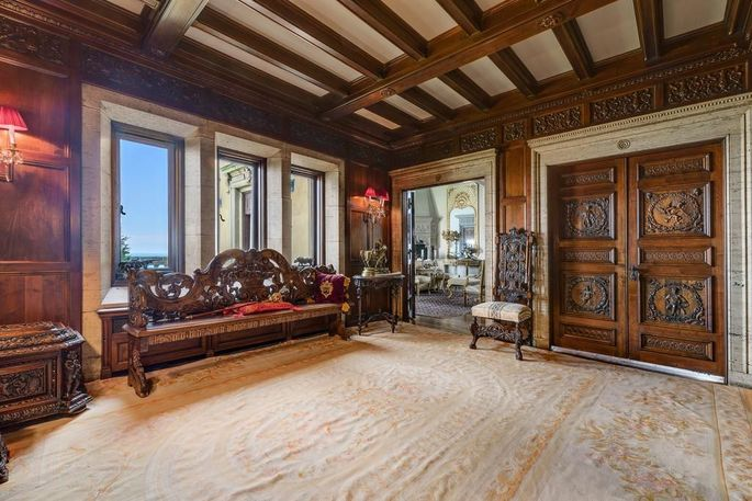 Hand-carved doors and coffered ceilings